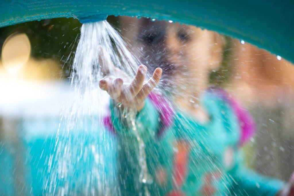 spraying water toddler